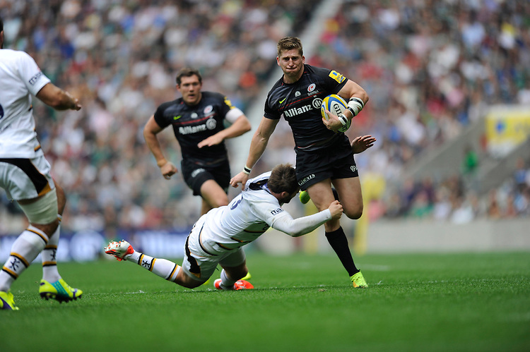 David Strettle of Saracens hands off Elliot Daly of Wasps to score a try during the Premiership Rugby Round 1 match between Saracens and Wasps at Twickenham Stadium on Saturday 6th September 2014 (Photo by Rob Munro)