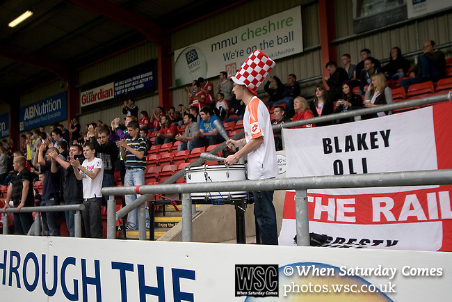 Crewe Alexandra 1 Aldershot 2, 09/09/2009. Gresty Road, League 2. A fan of Crewe Alexandra beating his drum in the AB Nutrition stand of the Alexandra Stadium during his teams' League 2 match against Aldershot Town. The visitors won by 2 goals to 1. Photo by Colin McPherson.