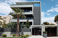 A modern three storey house located in the southern suburbs of Athens, Greece decorated by designer Stella Peponi-Philippou.