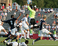 04 September 2009:Andrew Quinn #0 of the University of Notre Dame pulls in the ball over Ike Opara #23 of Wake Forest University during an Adidas Soccer Classic match at the University of Indiana in Bloomington, In. The game ended in a 1-1 tie..