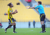 Phoenix captain Andrew Durante reacts to a decision by referee Adam Kersey during the A-League football match between Wellington Phoenix and Melbourne Victory at Westpac Stadium, Wellington, New Zealand on Sunday, 31 March 2013. Photo: Dave Lintott / lintottphoto.co.nz