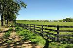 Union County estate with John Deere mowing field.