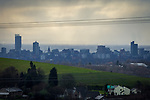 © Joel Goodman - 07973 332324 . 20/02/2014 . Manchester , UK . Landscape view across Manchester taken from Saddleworth near Oldham , featuring the city's iconic Beetham Tower on the left and the Piccadilly Tower Town Hall and Arndale Centre to its right . Photo credit : Joel Goodman