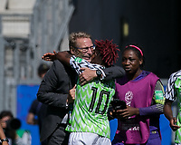 GRENOBLE, FRANCE - JUNE 12: Thomas Dennerby celebrates with Rita Chikwelu #10 of the Nigerian National Team during a game between Korea Republic and Nigeria at Stade des Alpes on June 12, 2019 in Grenoble, France.