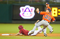 Taylor Dugas #1 of the Alabama Crimson Tide is tagged out by Casey McElroy #23 of the Auburn Tigers as he tries to steal second base at Riverwalk Park on March 15, 2011 in Montgomery, Alabama.  Photo by Brian Westerholt / Four Seam Images