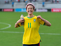 ORLANDO, FL - FEBRUARY 21: Megan Rapinoe #15 of the USWNT shows off a jersey she traded with Cristiane #11 of Brazil after a game between Brazil and USWNT at Exploria Stadium on February 21, 2021 in Orlando, Florida.