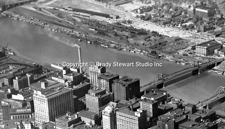 Pittsburgh PA:  Aerial View of the North Side and Allegheny River.  The city of Pittsburgh and the 6th Street bridge in the foreground.