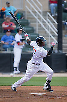 Micker Adolfo (27) of the Kannapolis Intimidators follows through on his swing against the Delmarva Shorebirds at Kannapolis Intimidators Stadium on April 21, 2016 in Kannapolis, North Carolina.  The Intimidators defeated the Shorebirds 9-3.  (Brian Westerholt/Four Seam Images)