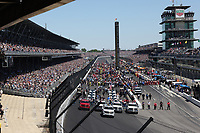 30th May 2021, Indianapolis, Indiana, USA;  Crews gather around the cars on the grid before the start of the 105th running of the Indianapolis 500 on May 30, 2021 at the Indianapolis Motor Speedway in Indianapolis, Indiana.