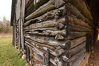 Logs notched by hand fit together     March 12 2021  on a barn at the farmstead.<br />