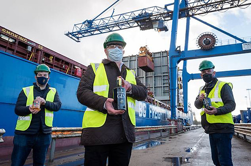 Ernest Cantillon, Colin Ross and Tom O'Riordan from Kinsale Spirit Company in the Port of Cork as the first container of Kinsale Gin & Red Earl Irish Whiskey is exported to China from Cork