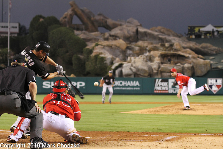 Paul Konerko of the White Sox singles off Scott Kaszmir of the Angels with a runner in scoring position.