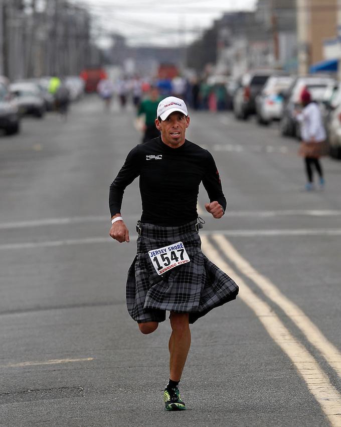 The winner of the world record-setting 2014 Jersey Shore Kilt Run 2-mile race at the Manasquan beachfront on Sat., March, 22, 2014.