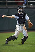 Stetson Hatters catcher Austin Hale (18) throws to first base during a game against the Siena Saints on February 23, 2016 at Melching Field at Conrad Park in DeLand, Florida.  Stetson defeated Siena 5-3.  (Mike Janes/Four Seam Images)