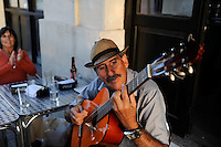 URUGUAY Montevideo, guitar player at pub at port