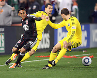 Andy Najar#14 of D.C. United goes for a loose ball with Dilly Duka#11 and Rich Balchan#2 of the Columbus Crew during the opening match of the 2011 season at RFK Stadium, in Washington D.C. on March 19 2011.D.C. United won 3-1.