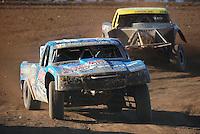 Apr 17, 2011; Surprise, AZ USA; LOORRS driver Robby Woods (99) leads Rob Naughton (54) during round 4 at Speedworld Off Road Park. Mandatory Credit: Mark J. Rebilas-