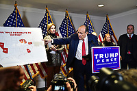 Former Mayor Rudy Giuliani (Republican of New York, New York) shows a chart as he conducts a press conference at Republican National Committee headquarters in Washington, DC on Thursday, November 19, 2020.  He is accompanied by Trump Campaign Senior Legal Advisor Jenna Ellis.<br />