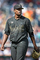 Vanderbilt Commodores pitcher Kumar Rocker (80) walks off the mound during Game 8 of the NCAA College World Series against the Mississippi State Bulldogs on June 19, 2019 at TD Ameritrade Park in Omaha, Nebraska. Vanderbilt defeated Mississippi State 6-3. (Andrew Woolley/Four Seam Images)