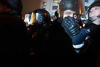 Ukrainain policeman covers his nose from the tear gas sprayed by provocators trying to raise a conflict on European square in Kiev, Ukraine. Thousands of people are continuing to express their support to european integration and protesting against decision of Ukrainian government to refuse signing of association with EU in Vilnius.