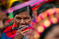 """A native woman from the Kamentsá tribe, wearing a colorful costume, plays harmonica during the Carnival of Forgiveness, a traditional indigenous celebration in Sibundoy, Colombia, 12 February 2013. Clestrinye (""""Carnaval del Perdón"""") is a ritual ceremony kept for centuries in the Valley of Sibundoy in Putumayo (the Amazonian department of Colombia), a home to two closely allied indigenous groups, the Inga and Kamentsá. Although the festival has indigenous origins, the Catholic religion elements have been introduced and merged with the shamanistic tradition. Celebrating annually the collaboration, peace and unity between tribes, they believe that anyone who offended anyone may ask for forgiveness this day and all of them should grant pardons."""