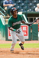 Rashawn Payne (19) of the Augusta GreenJackets follows through on his swing against the Greensboro Grasshoppers at NewBridge Bank Park on August 11, 2013 in Greensboro, North Carolina.  The GreenJackets defeated the Grasshoppers 6-5 in game one of a double-header.  (Brian Westerholt/Four Seam Images)