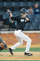 Evan Stephens (5) of the Wake Forest Demon Deacons follows through on his swing against the Missouri Tigers at Wake Forest Baseball Park on February 22, 2014 in Winston-Salem, North Carolina.  The Demon Deacons defeated the Tigers 1-0.  (Brian Westerholt/Four Seam Images)