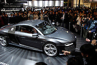 Visitors look at an Audi R8 during during the 2006 International Automotive Exhibition in Beijing, China. .25 Nov 2006