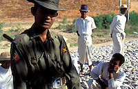 © Nic Dunlop / Panos Pictures..Mandalay, BURMA...Guard watching prisoners undergoing forced labour at Mandalay Palace.