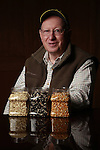 Clarkson Grain founder and president Lynn Clarkson, shown with non-genetically modified seeds processed at the company's plant near Cerro Gordo, Ill., where they prepare non-GMO corn for food processors. Food companies' move toward non-genetically modified ingredients has increased demand for the limited supply of non-GMO crops.<br /> Kristen Schmid