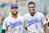 Pensacola Blue Wahoos outfielders Narciso Crook (8) and Aristides Aquino (6) before a game against the Tennessee Smokies at Smokies Stadium on August 30, 2018 in Kodak, Tennessee. The Blue Wahoos defeated the Smokies 5-1. (Tony Farlow/Four Seam Images)