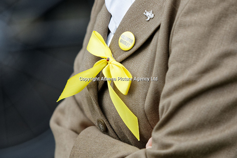 """Pictured: A yellow ribbon and a badge worn in tribute to Bradley John by a mourner at Aberavon Beach Hotel, Wales, UK. Monday 08 October 218<br /> Re: A grieving father will mourners on horseback at the funeral of his """"wonderful"""" son who killed himself after being bullied at school.<br /> Talented young horse rider Bradley John, 14, was found hanged in the school toilets by his younger sister Danielle.<br /> Their father, farmer Byron John, 53, asked the local riding community to wear their smart hunting gear at Bradley's funeral.<br /> Police are investigating Bradley's death at the 500-pupils St John Lloyd Roman Catholic school in Llanelli, South Wales.<br /> Bradley's family claim he had been bullied for two years after being diagnosed with Attention Deficit Hyperactivity Disorder.<br /> He went missing during lessons and was found in the toilet cubicle by his sister Danielle, 12."""