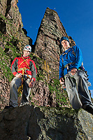 Dave Macleod (right) and Andy Turner (left) posing for portraits 2 days after climbing the Longhope Route on St John's Head with the headwall looming behind them.
