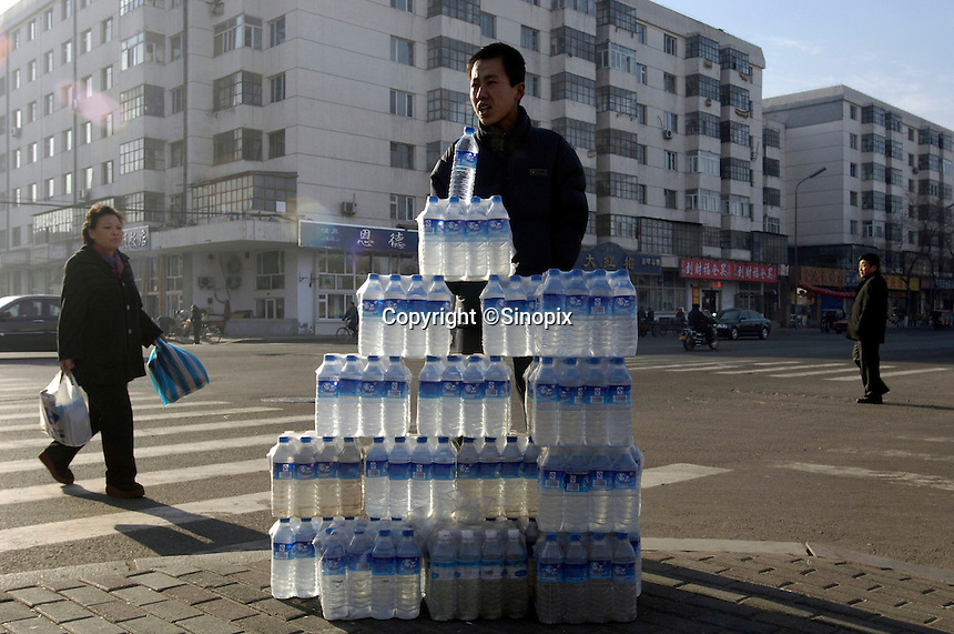 A man sells water in  Harbin, where a spillage of carcinogenic benzene severely polluted this, one of China's biggest rivers after a chemical plant explosion in the neighbouring province of Jilin causing water supplies in the city to be cut for millions of people. Millions of residents endured their third full day without running water due to the toxic chemical spill, as the government worked frantically to clean up the pollution..25 Nov 2005