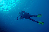 France marseille a swimming scuba diver with a an underwater photo housing in hands