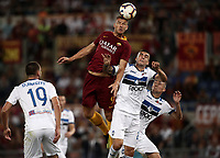 Calcio, Serie A: Roma - Atalanta, Stadio Olimpico, 27 agosto, 2018.<br /> Roma's Edin Dzeko (c) in action with Atalanta's Gianluca Mancini (second from right) Timothy Castagne (r) and Berat Djimsiti (l) during the Italian Serie A football match between Roma and Atalanta at Roma's Stadio Olimpico, August 27, 2018.<br /> UPDATE IMAGES PRESS/Isabella Bonotto