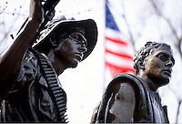 Alternative Vietnam Veterans War Memorial, with statue of soldiers , weapons, American flag, detail #5412. Washington DC.