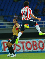 PEREIRA -COLOMBIA-02-08-2014. Johan Fano (Izq) jugador de Aguilas Doradas disputa el balón con Nery Bareiro (Der) jugador de Atletico Junior en partido por la fecha 3 de la Liga Postobón II 2014 jugado en el estadio Hernán Ramírez Villegas de Pereira./ Johan Fano (L) player of Aguilas Doradas fights the ball with Nery Bareiro (R) player of Atletico Junior for the third date of the Postobon Cup 2014 played at Hernan Ramirez Villegas of Pereira city.  Photo:VizzorImage/ CONT