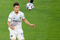 CARSON, CA - JUNE 19: Jorge Villafana #19 of the Los Angeles Galaxy gets after a loose ball during a game between Seattle Sounders FC and Los Angeles Galaxy at Dignity Health Sports Park on June 19, 2021 in Carson, California.