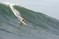 "Grant ""Twiggy"" Baker sticks this run at  Mavericks Surf Contest 2008.  Half Moon Bay, Ca.  January 12, 2008."