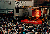July 1996 File Photo<br /> <br /> A crowd of Jazz fans gather to listen to one of many free outdoor concert on Ste-Catherine Street in downtown Montreal, during the 1996 Jazz Festival.<br /> <br /> (Photo by Pierre Roussel - Images Distribution)<br /> ON SPEC<br /> NOTE : Scan