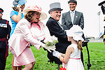 Five yerar-old Ashley   presents flowers to Lieutenant Governor , David Onley's, wife  at the 155th Queen's Plate at Woodbine Race Course in Toronto, Canada on July 06, 2014.