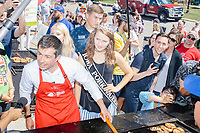 South Bend mayor and Democratic presidential candidate Pete Buttigieg grills meat at the Iowa Pork Producers Association Pork Tent at the Iowa State Fair in Des Moines, Iowa, on Tues., Aug. 13, 2019.