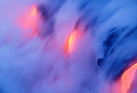 Glowing lava flow reaching the sea, Hawaii Volcanoes National Park