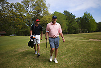 Marc Bryant (right) plays a round of golf with his son Taylor Bryant, Monday, April 26, 2021 at the Prairie Creek golf course in Rogers. The Prairie Creek golf course is closing after 50 years of ownership in the Rountree family. Check out nwaonline.com/210427Daily/ for today's photo gallery. <br /> (NWA Democrat-Gazette/Charlie Kaijo)