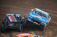 Dec. 11, 2011; Chandler, AZ, USA; LOORRS pro two unlimited driver Robby Woods (right) makes contact with Todd LeDuc during the Lucas Oil Challenge Cup at Firebird International Raceway. Mandatory Credit: Mark J. Rebilas-