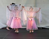 Girls wearing pink dresses performing Chinese White Vail Dance, Northwest Folklife Festival 2016, Seattle Center, Washington, USA.