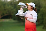 South Korean Inbee Park kisses the LPGA Championship after winning the major at Locust Hill Country Club in Pittsford, NY on June 9, 2013