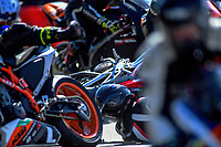 Formula three race two, crash at the first corner following start. The 2019 Suzuki series Cemetery Circuit motorcycle racing at Cooks Gardens in Wanganui, New Zealand on Thursday, 26 December 2019. Photo: Dave Lintott / lintottphoto.co.nz