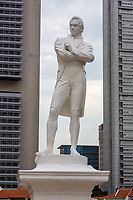 Statue of Sir Thomas Raffles, at 1819 Landing Point, Singapore.  Financial District Buildings in background.